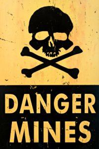danger mines warning sign closeup