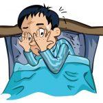 Boy in bed afraid of something